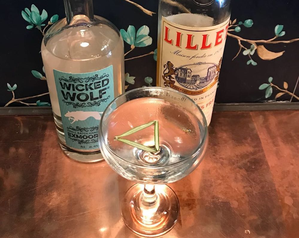 gin glass wicked wolf gin bottle lillet vermouth rosemary sprigs