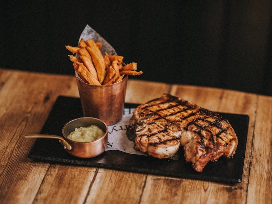 steak and chips on board