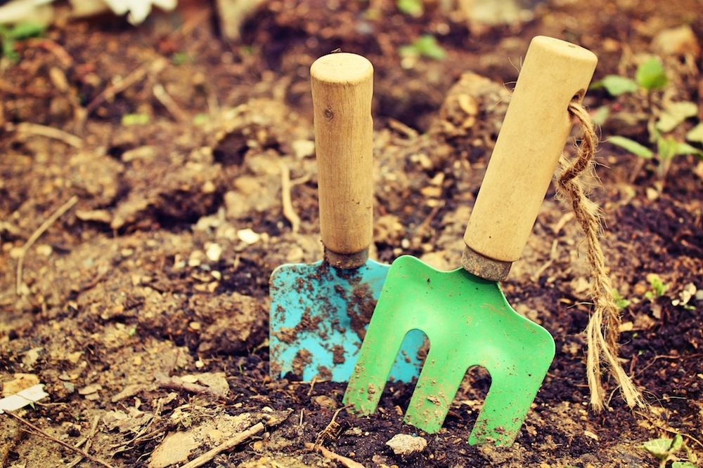 towel and child's trowel in soil
