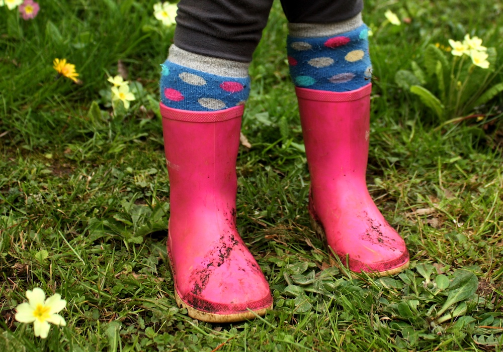 toddler in pink wellies
