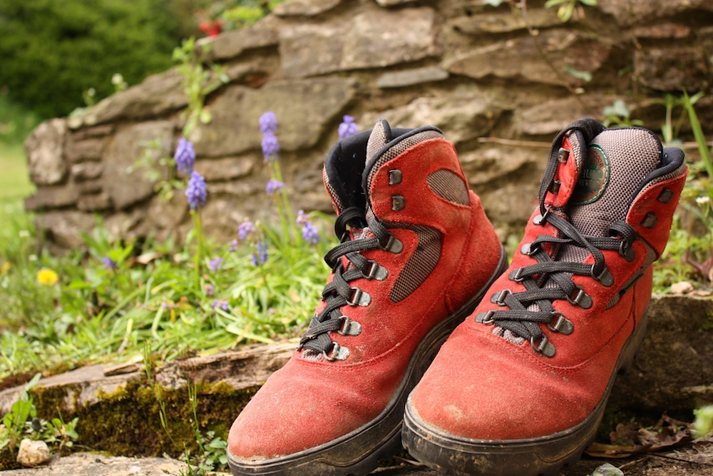 red hiking boots on doorstep with grass