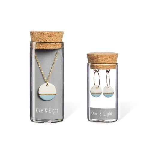 blue and white ceramic necklace and earrings in glass bottles