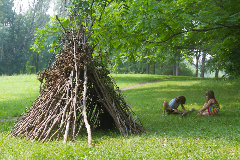 Willow wigwam children in field