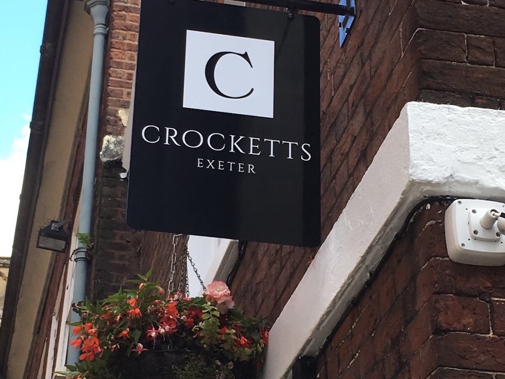 Black and white sign above door Crocketts