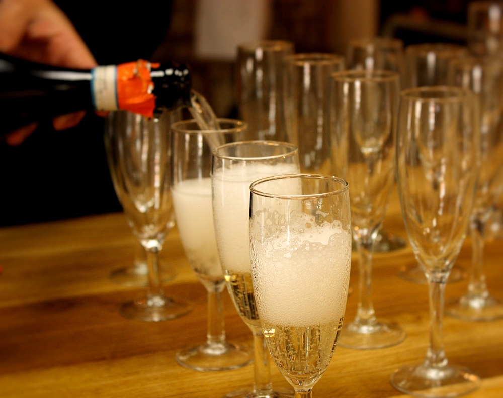 prosecco being poured into glasses