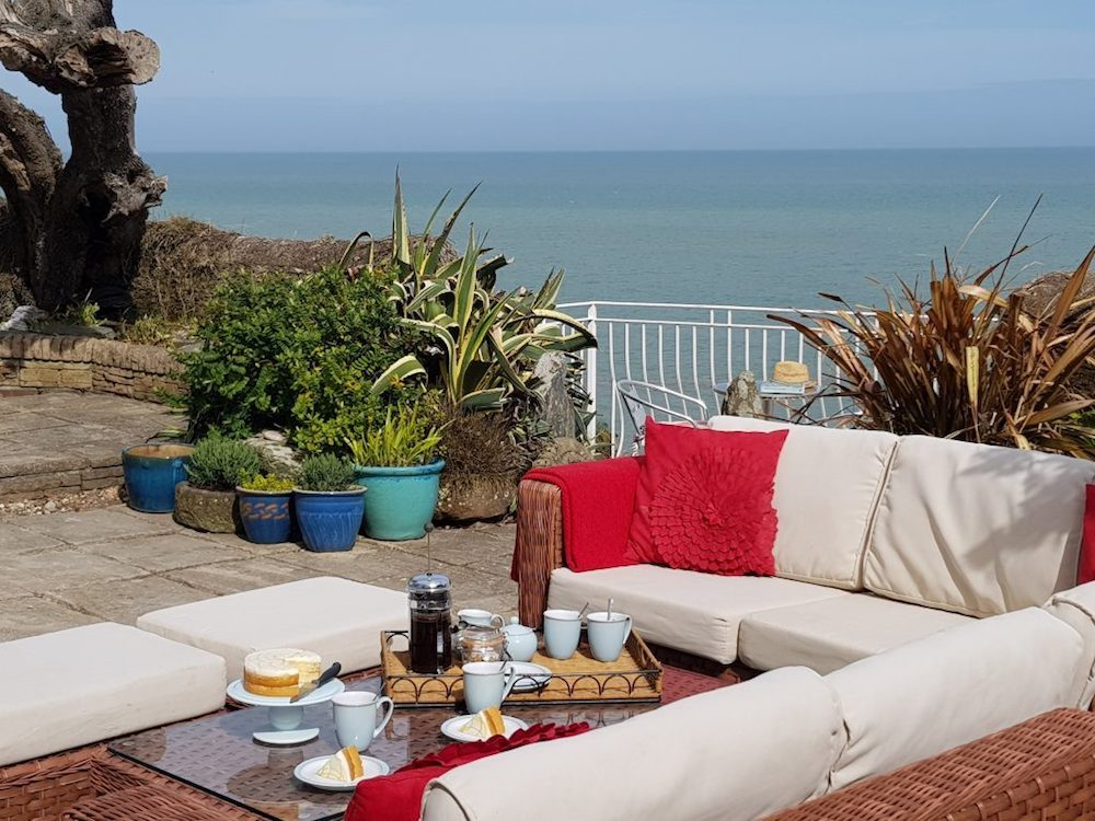 outdoor seating red cushions sea view