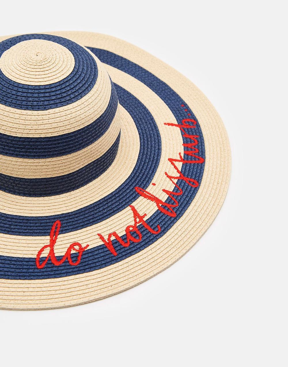 navy striped straw hat with red writing