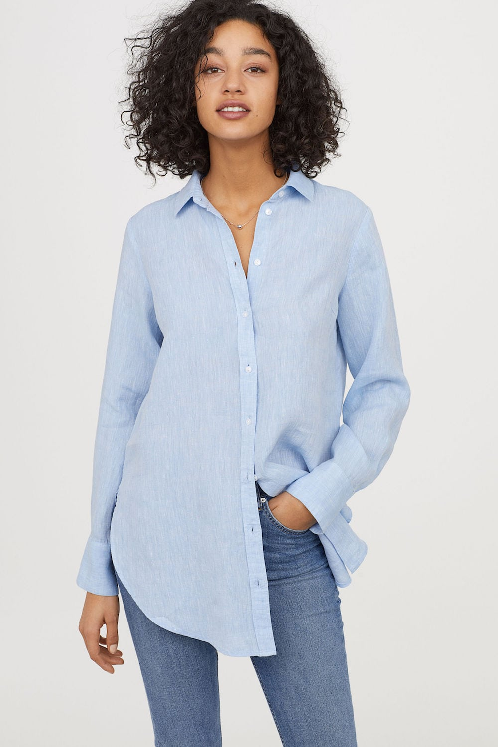 woman in oversized blue shirt