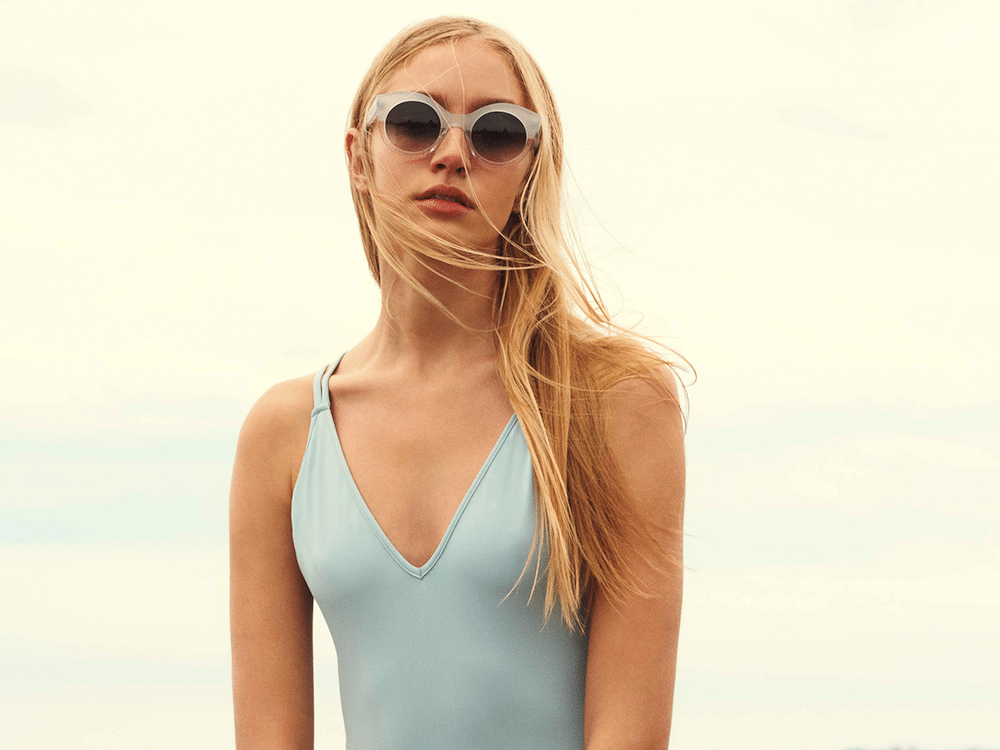 blonde woman in sunglasses and blue vest