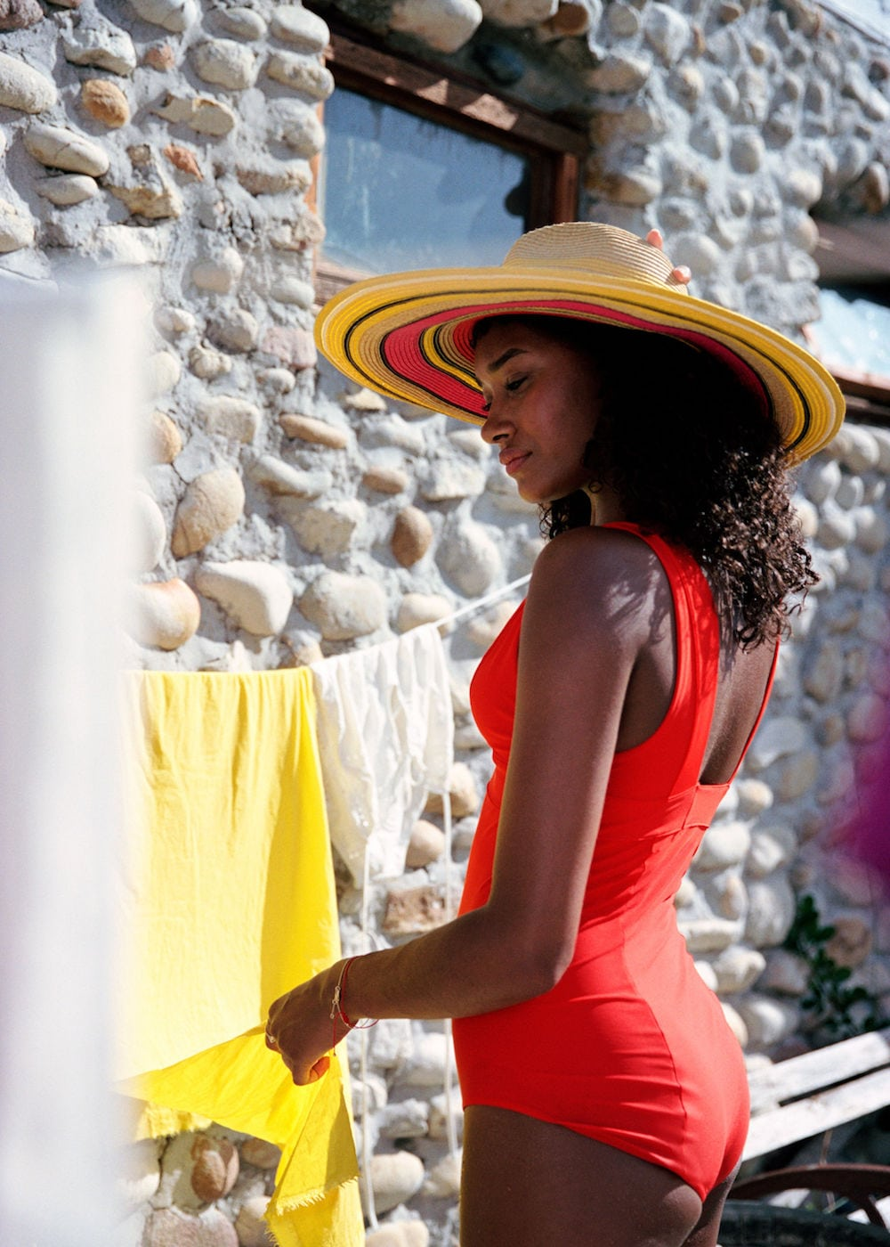 woman in red swimsuit and straw hat