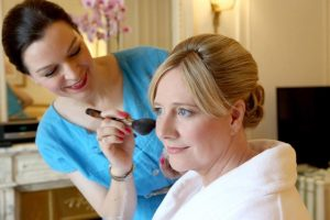 woman doing bride's make-up