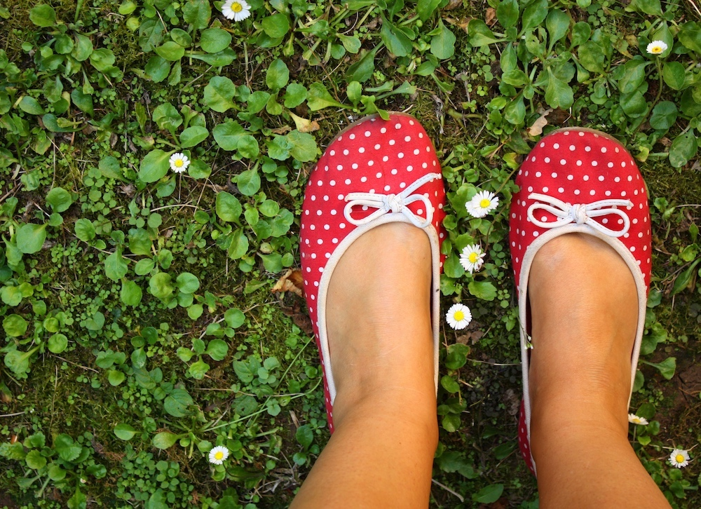 red spotty shoes on grass