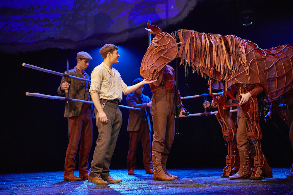 mechanical horse on stage with actor