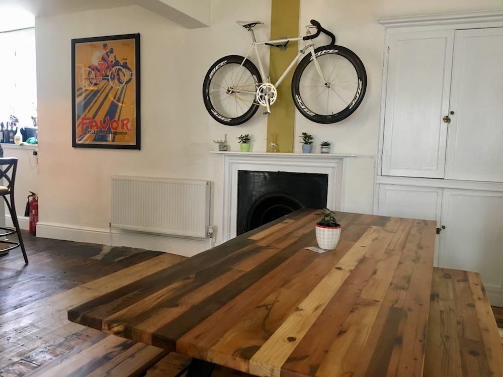 bicycle above fireplace