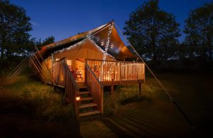 glamping tent at night fairy lights