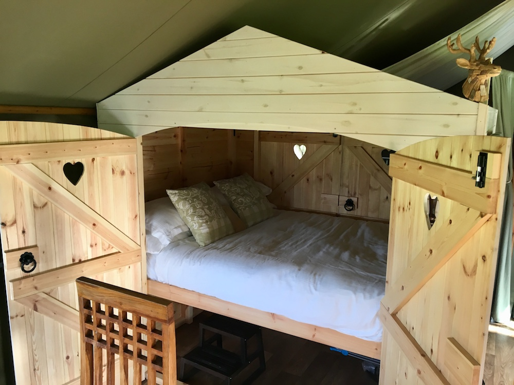 cupboard bed in tent open