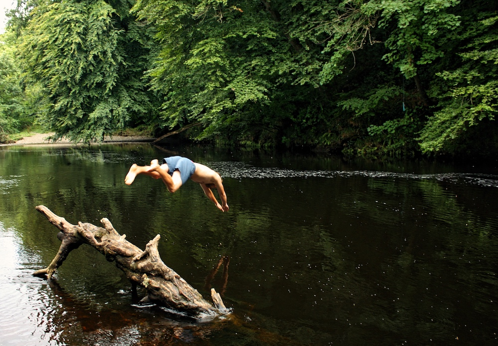 boy diving into river