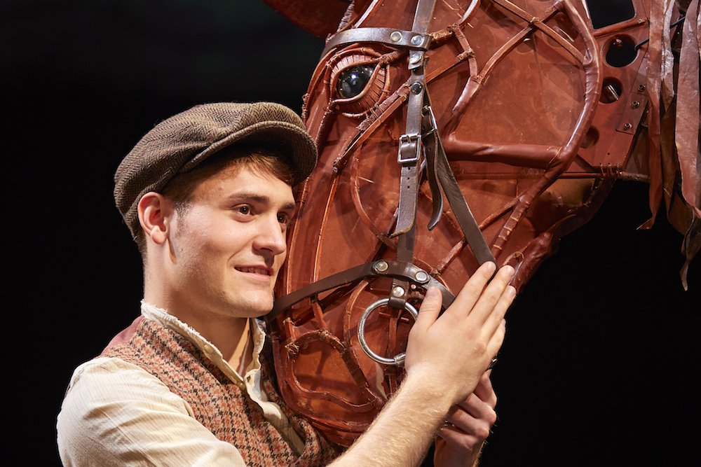 man and horse on stage