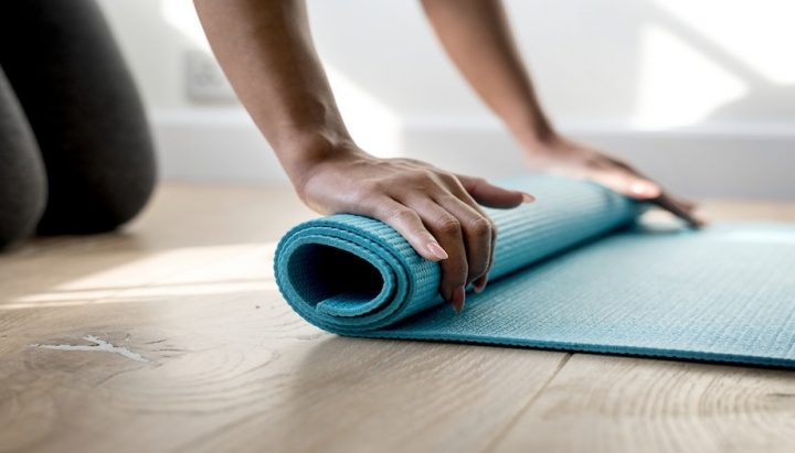 yoga mat on wooden floor