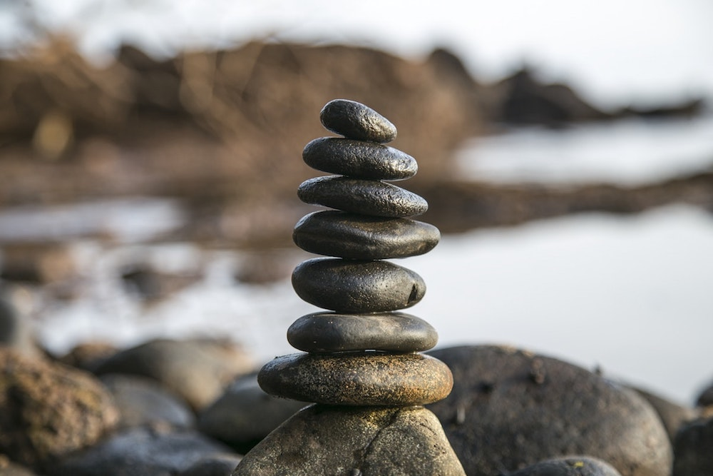 stones balanced on beach