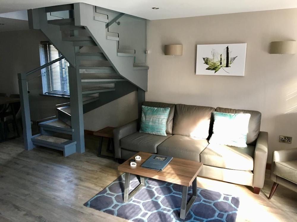open plan lounge with spiral stairs