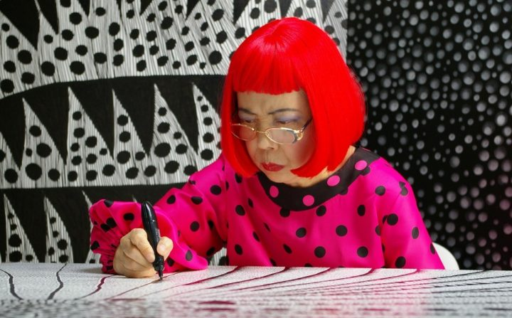 woman with red hair and pink top drawing