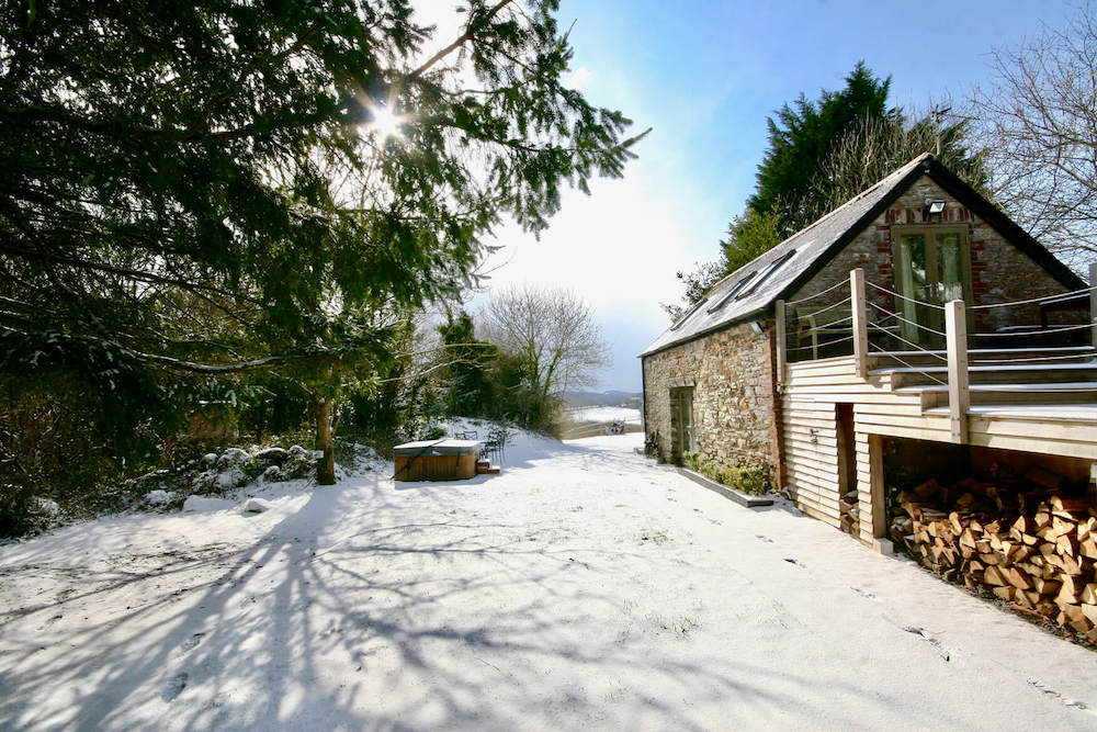 barn in snow with blue sky