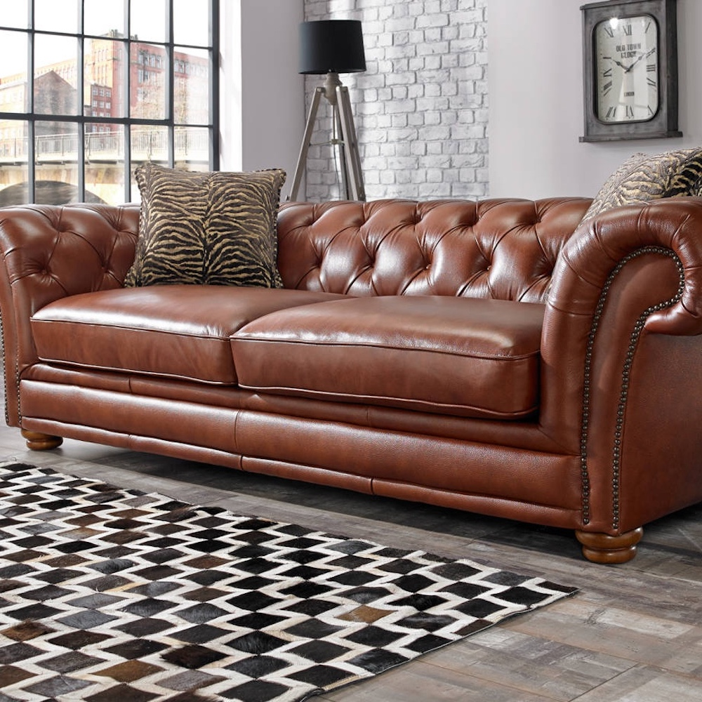 brown leather chesterfield sofa checked rug