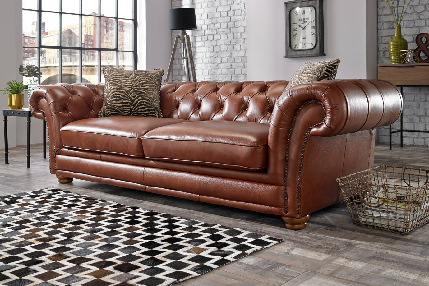 brown leather chesterfield style sofa