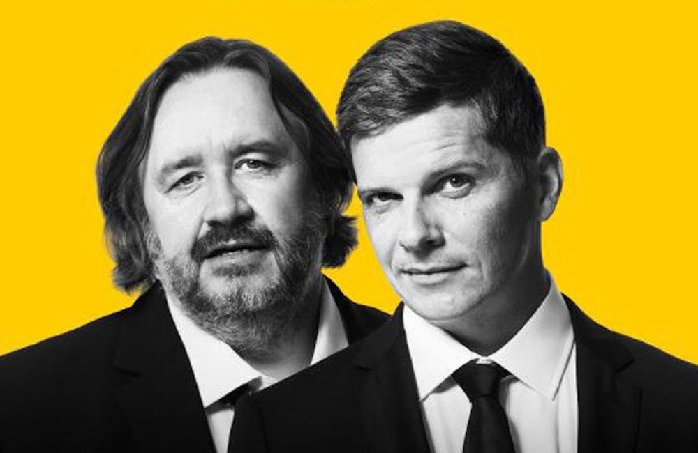 men in suits on yellow background