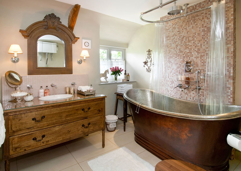 bathroom with copper bathtub and antique sink