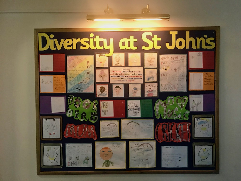 A pin board showing aspects of diversity at St John's school in Sidmouth.