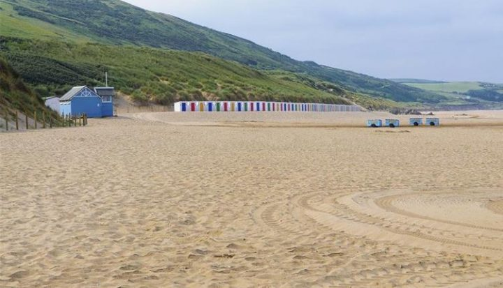 Golden sands and beach huts at Woolacombe, North Devon